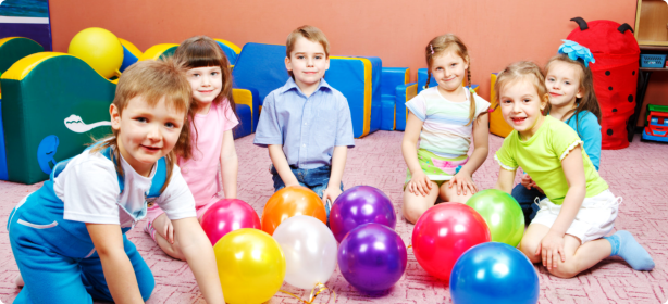 students playing balloons